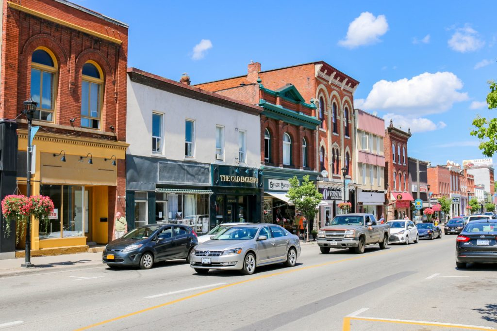 Hometown Stories main image of quaint downtown with traffic