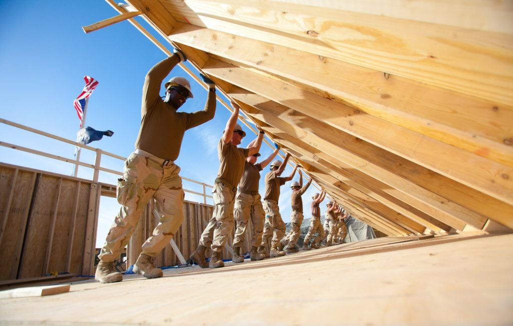 Recommended Home Resources Main Image of constructions workers lifting a wall